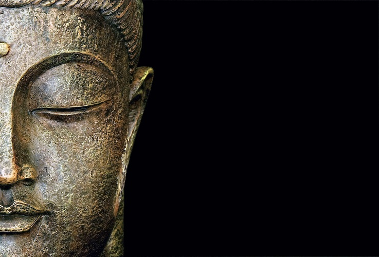 Statue representing the portrait of Buddha in meditation. Copy space.